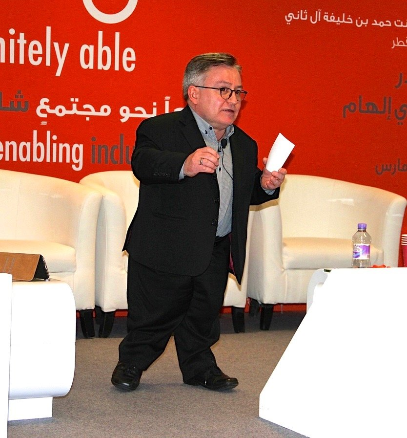 Simon at conference in Qatar